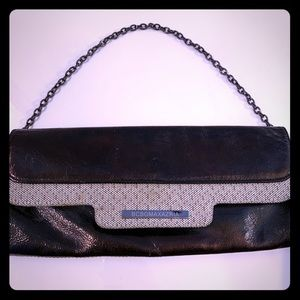 BCBGMaxAzria Black Clutch with Pewter Chain.